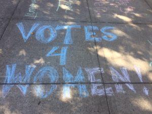 'Votes for Women' in chalk on sidewalk